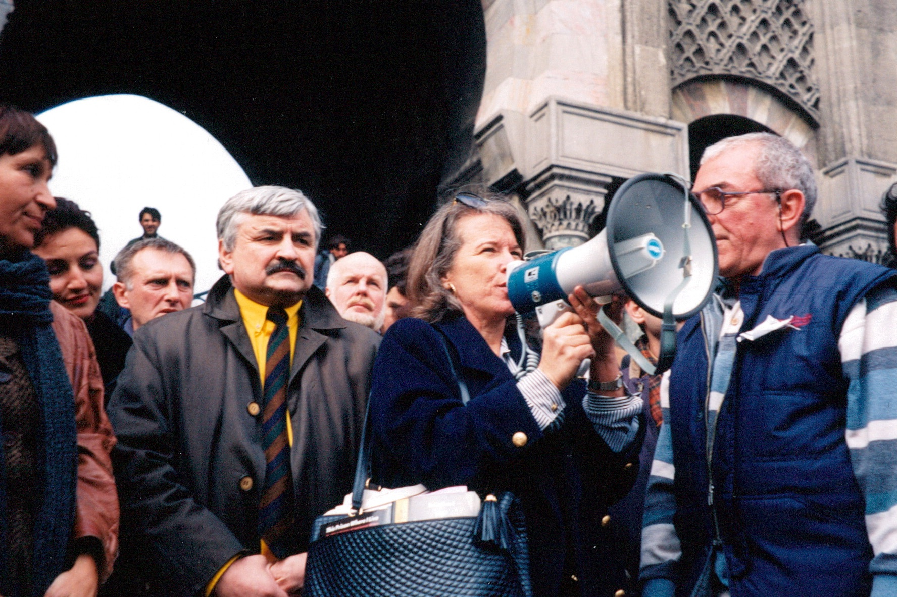 Joanne Leedom-Ackerman, then chair of the Writers in Prison Committee of PEN International at a protest rally held at Istanbul University on 11 March 1997, during the first Gathering in Istanbul for Freedom of Expression. To her left, Alexander Tkachenko, then general secretary of the Russian Centre (1994-2007). These PEN members were in Turkey for the first Gathering in Istanbul for Freedom of Expression, which took place on 10-12 March 1997, and at which a delegation from PEN International's Writers in Prison Committee were in attendance - headed by the committee's then chair Leedom-Ackerman.